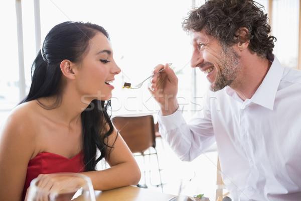 Man feeding food to woman Stock photo © wavebreak_media