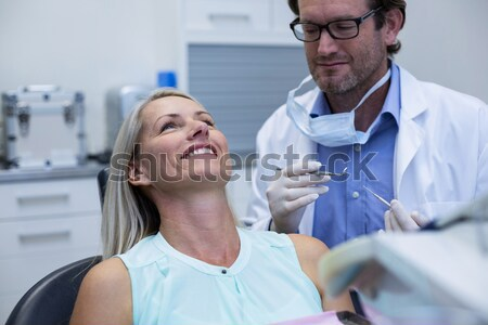 Optometrist discussing on messbrille with female patient Stock photo © wavebreak_media