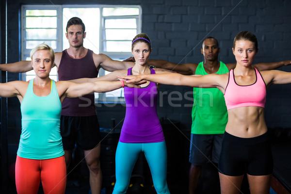 Fiatal határozott sportolók testmozgás tornaterem portré Stock fotó © wavebreak_media