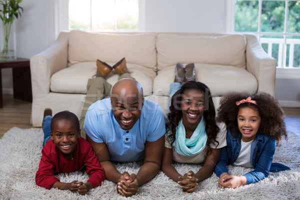 Portrait of happy family lying on the floor Stock photo © wavebreak_media