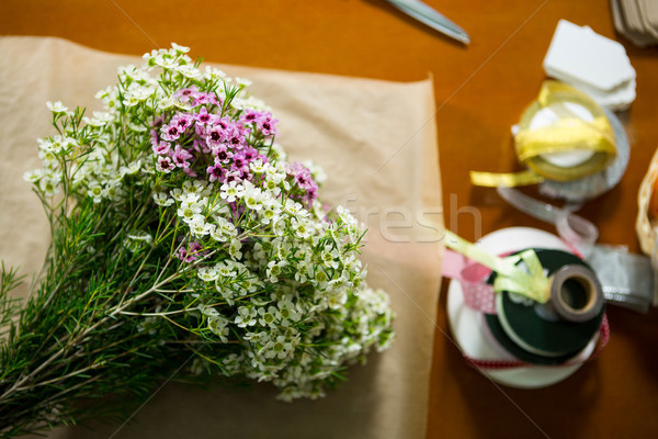 Flowers on the wooden worktop at flower shop Stock photo © wavebreak_media