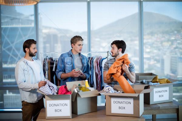 Twórczej zespół firmy ubrania darowizna polu biuro Zdjęcia stock © wavebreak_media