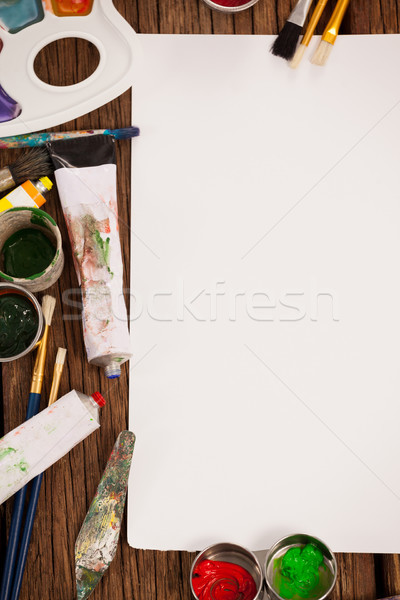 Watercolor paint and paint brushes and white paper Stock photo © wavebreak_media