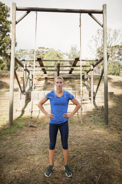 Portrait of woman standing with her hands on hip during obstacle course Stock photo © wavebreak_media
