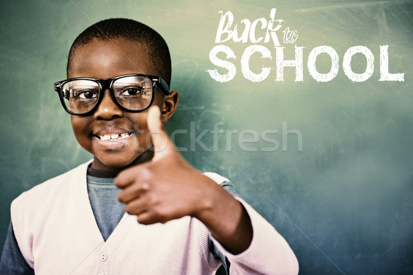 Composite image of cute pupil showing thumbs up Stock photo © wavebreak_media