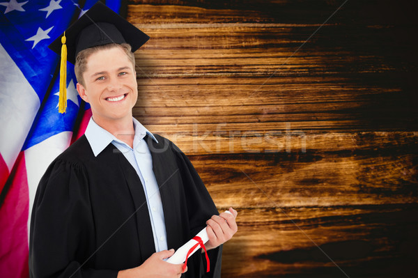 Composite image of a smiling man with a degree in hand as he loo Stock photo © wavebreak_media