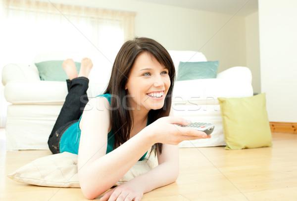 Stock fotó: örömteli · nő · tv · nézés · nappali · televízió · technológia