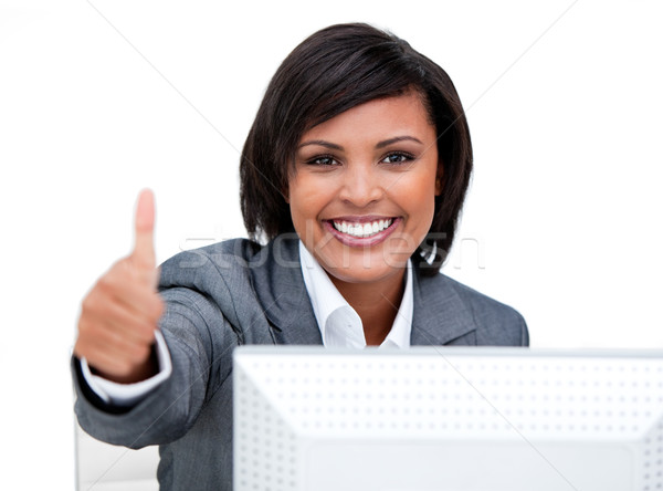 Cheerful businesswoman with a thumb up working at a computer Stock photo © wavebreak_media