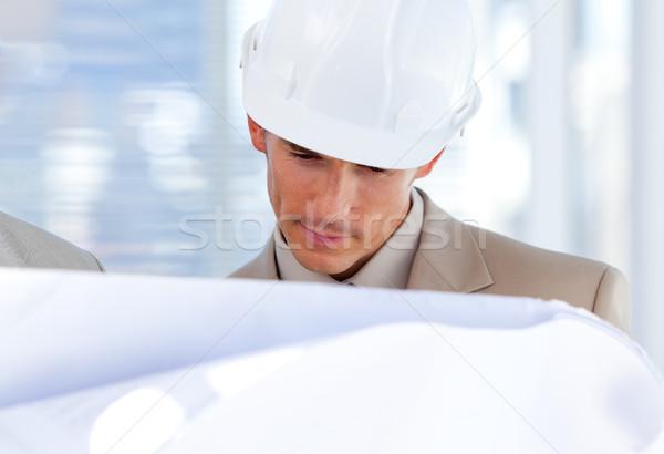 Architect looking at blueprint Stock photo © wavebreak_media