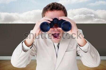 Joyful businesswoman predicting future success through binocular Stock photo © wavebreak_media
