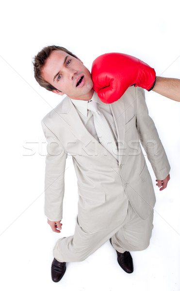 Caucasian businessman being hit with a boxing glove  Stock photo © wavebreak_media