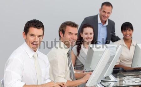 улыбаясь менеджера гарнитура команда служба бизнеса Сток-фото © wavebreak_media