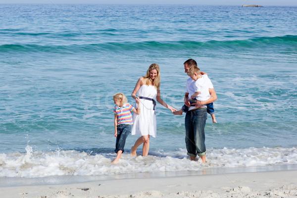 Animated family having fun at the beach Stock photo © wavebreak_media