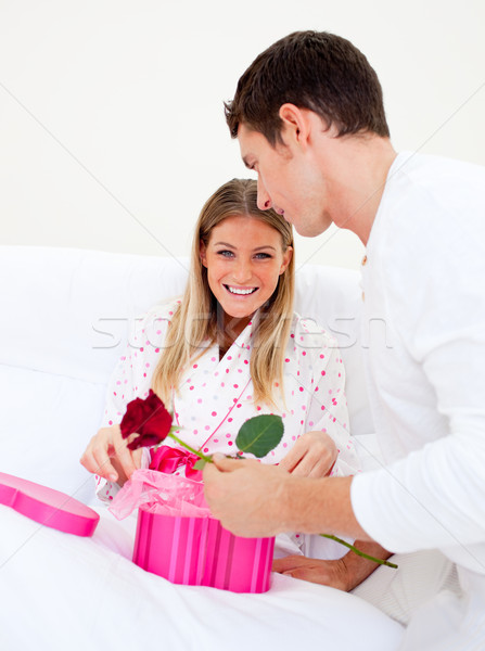 Attractive husband giving a present to his wife Stock photo © wavebreak_media