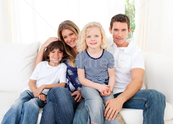 Gioioso famiglia seduta divano home Foto d'archivio © wavebreak_media