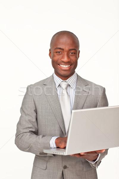 Сток-фото: бизнесмен · используя · ноутбук · улыбаясь · камеры · белый · стороны