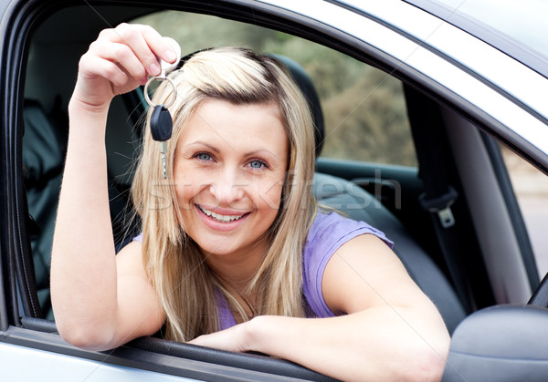 Happy young driver holding a key after bying a new car Stock photo © wavebreak_media
