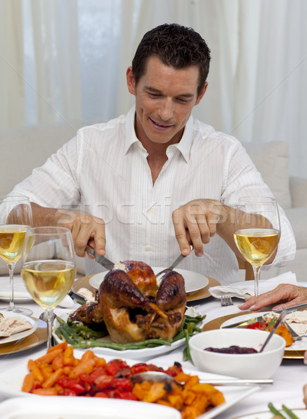 Attractive man eating turkey in Christmas dinner Stock photo © wavebreak_media