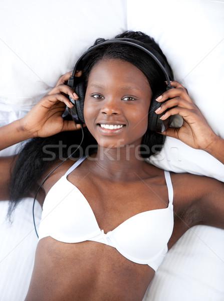 Parlak kadın iç çamaşırı dinleme müzik seksi Stok fotoğraf © wavebreak_media