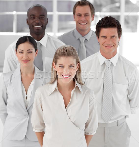 üzleti csoport öt ember néz kamera mosolyog férfiak Stock fotó © wavebreak_media
