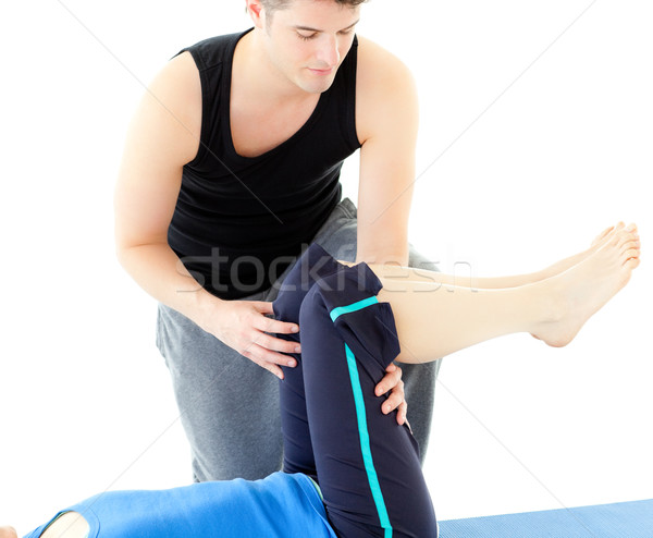 Caucasian woman exercising assited by her personal trainer Stock photo © wavebreak_media