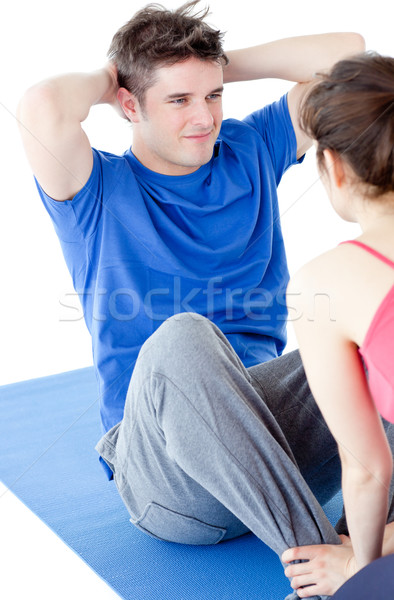 Young man doing fitness exercises with a woman in gym Stock photo © wavebreak_media