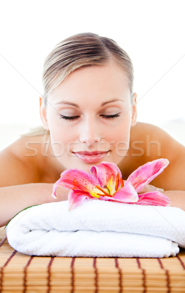 Portrait of a relaxed young woman lying on a massage table in a spa center Stock photo © wavebreak_media