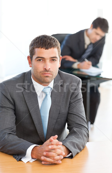 カリスマ的な ビジネスマン 座って フォアグラウンド 同僚 作業 ストックフォト © wavebreak_media