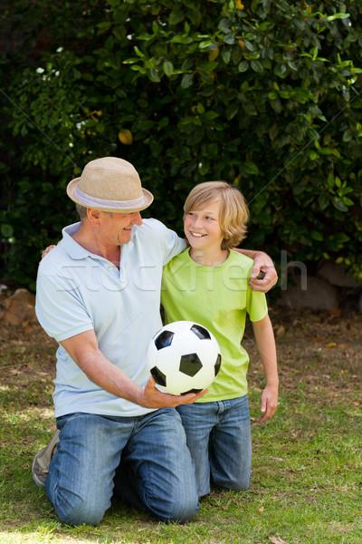 Abuelo nieto mirando cámara fútbol feliz Foto stock © wavebreak_media