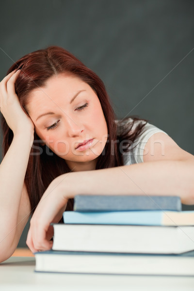 Young student fallling asleep with her forearm on her books in a classroom Stock photo © wavebreak_media