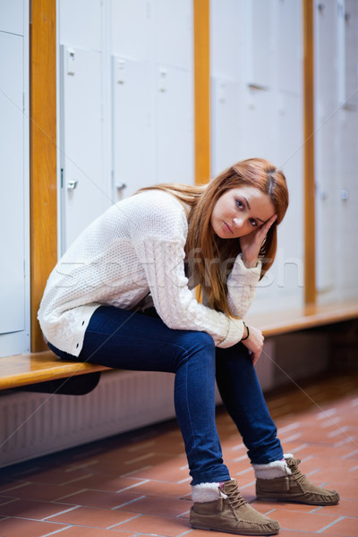 Portrait of a sad student sitting on a bench looking at the camera Stock photo © wavebreak_media