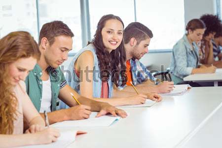 Studious young adults listening a lecturer in a classroom Stock photo © wavebreak_media