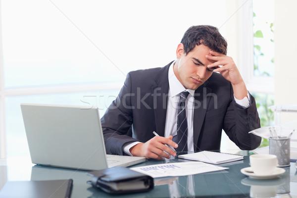 Focused businessman working in his office Stock photo © wavebreak_media