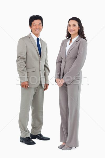 Smiling trading partners standing against a white background Stock photo © wavebreak_media