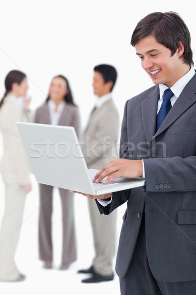 Verkoper notebook team achter witte business Stockfoto © wavebreak_media