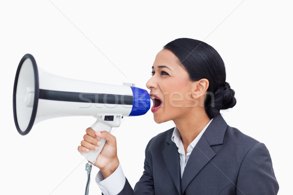 Close up of saleswoman yelling through megaphone against a white background Stock photo © wavebreak_media