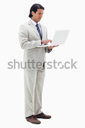 Glimlachend vrouwelijke ondernemer werken laptop witte Stockfoto © wavebreak_media
