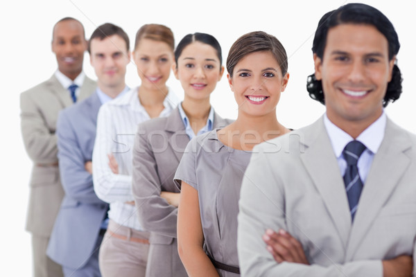 Big close-up of happy colleagues in a single line with focus on the first woman Stock photo © wavebreak_media