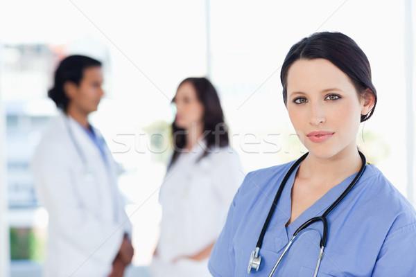 Young nurse calmly standing upright with her stethoscope around her neck Stock photo © wavebreak_media
