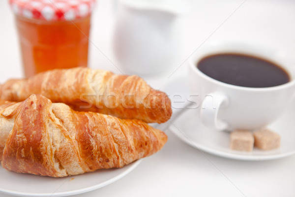 Croissants beker koffie witte platen suiker Stockfoto © wavebreak_media