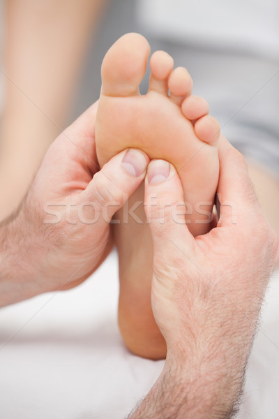 Hands massaging a foot on a medical table Stock photo © wavebreak_media