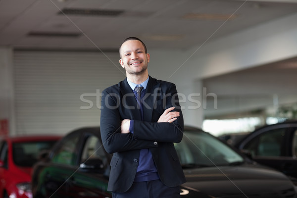 Dealer standing in front of a car in a garage Stock photo © wavebreak_media