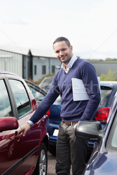 Man holding a car handle while holding a file outdoors Stock photo © wavebreak_media