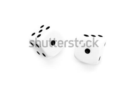 Black and white dices in motion against a white background Stock photo © wavebreak_media