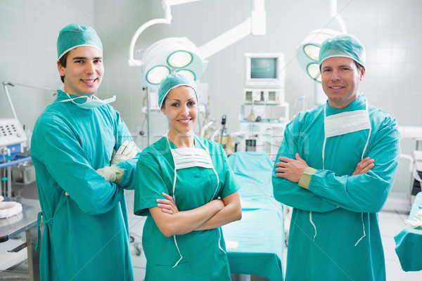 Surgeons standing up with arms crossed in an operating theatre Stock photo © wavebreak_media