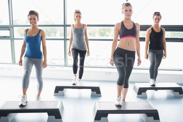 четыре женщины аэробика спортзал спорт осуществлять Сток-фото © wavebreak_media