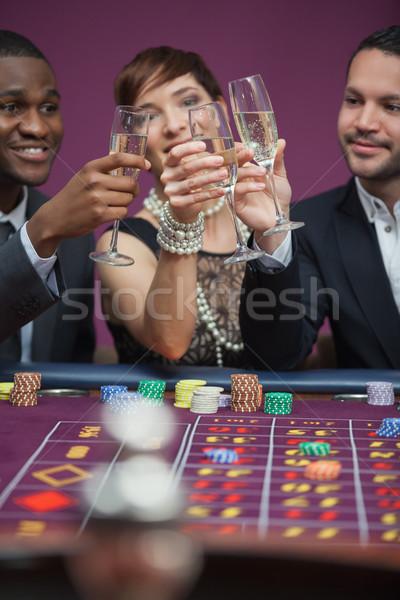 Trzy osoby ruletka tabeli kasyno kobieta Zdjęcia stock © wavebreak_media
