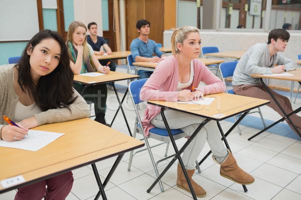 Öğrenciler oturma sınıf yazı kalem kalem Stok fotoğraf © wavebreak_media