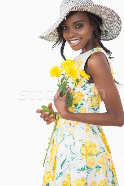 女性 立って 黄色の花 着用 ドレス ストックフォト © wavebreak_media
