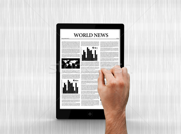 Hand scrolling through world news on digital tablet Stock photo © wavebreak_media